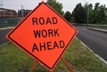 "image of orange ""road work ahead"" sign"
