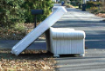 image of mattress and sofa at edge of street