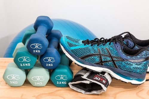 Fitness Photo with weights sneaker and yoga ball
