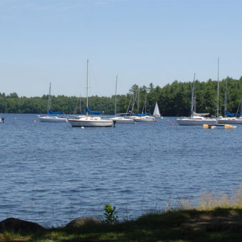 sail boats floating on Lake Massabesic Lake